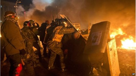 Protesters set up barricades around the Maidan square.