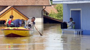 Bosnian citizens must now travel the streets of their hometown with rowboats.