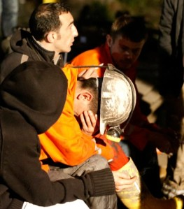 A Turkish miner weeps for his deceased colleagues.